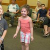 "Brett Outchcunis, better know as ""Ooch"", brought his Ooch World to the Leominster Public Library on Thursday afternoon. He entertained them with some yo-yo tricks and then some group dancing for everyone, even the parents. Kylie Trainque, 5, of Leominster was having a great time dancing with Ooch during his show. SENTINEL & ENTERPRISE/JOHN LOVE"