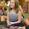 "Brett Outchcunis, better know as ""Ooch"", brought his Ooch World to the Leominster Public Library on Thursday afternoon. He entertained them with some yo-yo tricks and then some group dancing for everyone, even the parents. Enjoying the show is Sarah Bateman, 7, of Leominster. SENTINEL & ENTERPRISE/JOHN LOVE"