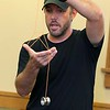 "Brett Outchcunis, better know as ""Ooch"", brought his Ooch World to the Leominster Public Library on Thursday afternoon. He entertained them with some yo-yo tricks and then some group dancing for everyone, even the parents. Here shows them all the Eiffel Tower Yoyo Trick. SENTINEL & ENTERPRISE/JOHN LOVE"