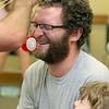 "Brett Outchcunis, better know as ""Ooch"", brought his Ooch World to the Leominster Public Library on Thursday afternoon. He entertained them with some yo-yo tricks and then some group dancing for everyone, even the parents. He has some fun with Doug Dalessandro of Leominster as he pretends to cut his nose hairs. SENTINEL & ENTERPRISE/JOHN LOVE"