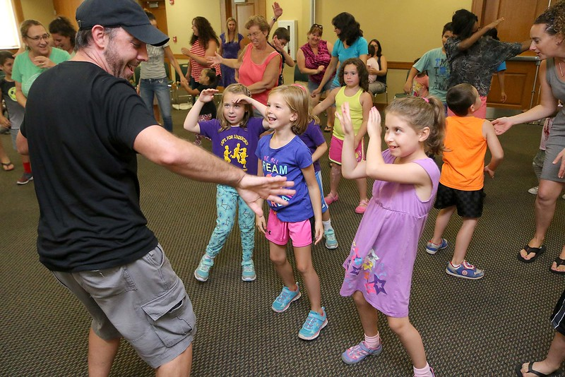"""Brett Outchcunis, better know as """"Ooch"""", brought his Ooch World to the Leominster Public Library on Thursday afternoon. He entertained them with some yo-yo tricks and then some group dancing for everyone, even the parents. SENTINEL & ENTERPRISE/JOHN LOVE"""