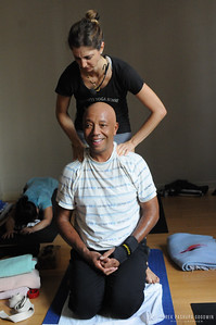Rima Rani Rabbath gives a yoga assist to Russell Simmons