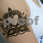 The Swan River Yoga logo, tattooed in henna by Laura Sheffield of New Orleans Henna.