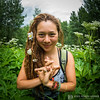 Mudra with flowers: a yogi with flowers on the magical hiking trails at Wanderlust Aspen