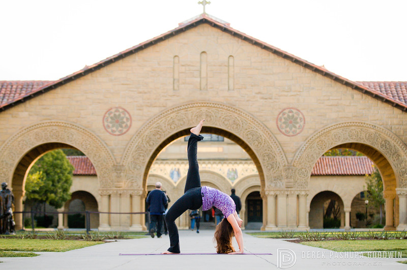 Jivamukti yogi Gisselle Mari embodies urdvha dhanurasana (wheel pose) in front of arches on the Stanford campus in California