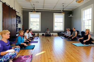 Anjali Desai of Burlington leads a gentle class at Yoga Center of Collinsville.  Photo by John Fitts