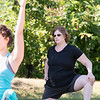 Fitchburg yoga instructor Cera Hawkins holds a class at Riverfront Park in the city on Friday mornings at 9:30. Participating in her class is Wiley Cordone from Clinton. SENTINEL & ENTERPRISE/JOHN LOVE