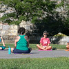 Fitchburg yoga instructor Cera Hawkins, back to camera, holds a class at Riverfront Park in the city on Friday mornings at 9:30. Participating in her class is, from left, Bethan Cordone from Clinton, Virginia L'Bassi and Alex L'Bassi from Sterling. SENTINEL & ENTERPRISE/JOHN LOVE