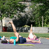 Fitchburg yoga instructor Cera Hawkins, in foreground, holds a class at Riverfront Park in the city on Friday mornings at 9:30. SENTINEL & ENTERPRISE/JOHN LOVE
