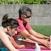 Fitchburg yoga instructor Cera Hawkins holds a class at Riverfront Park in the city on Friday mornings at 9:30. Participating in her class is Bethan Cordone from Clinton, in blue, and Virginia L'Bassi from Sterling. SENTINEL & ENTERPRISE/JOHN LOVESENTINEL & ENTERPRISE/JOHN LOVE