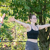 Fitchburg yoga instructor Cera Hawkins, on left, holds a class at Riverfront Park in the city on Friday mornings at 9:30. Participating in her class is Alex Mallard from Fitchburg. SENTINEL & ENTERPRISE/JOHN LOVE