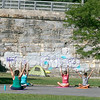 Fitchburg yoga instructor Cera Hawkins holds a class at Riverfront Park in the city on Friday mornings at 9:30. SENTINEL & ENTERPRISE/JOHN LOVE