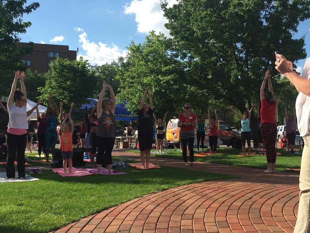 . photo by Tess Bloem  Yogapalooza kicks off Thrilling Thursdays in downtown Mt. Pleasant on June 15, 2017.