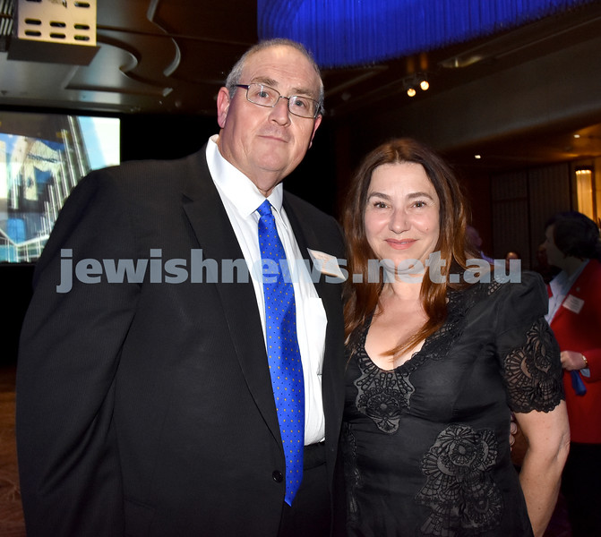 Yom Haatzmaut Communal Cocktail Party at the Shangri-La Hotel. Walt Secord (left), Julia Levetima. Pic Noel Kessel
