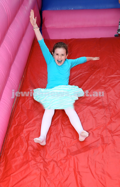 Yom Haatzmaut Fair at Moriah College. Liorah Kessel on the giant slide. Pic Noel Kessel.