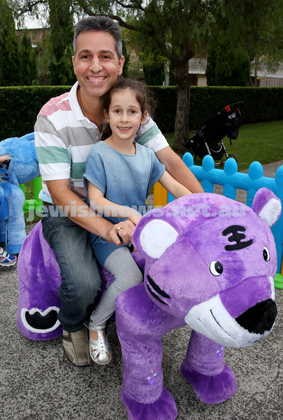 Yom Haatzmaut fair at Moriah College. Gil & Tali Mizrahi on a ride. Pic Noel Kessel.