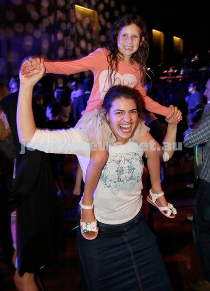 Yom Haatzmaut fair at Moriah College. Rachel Baruch dancing with Yali Neumann. Pic Noel Kessel.