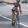 Sarah Redder pedals up Wareham St. while completing her bicycle portion of the race.