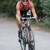 Vicky Mitchell of Middleboro pedals up the Camp Yomechas road to start her bicycle portion of the Triathlon.