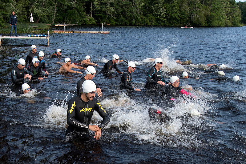 Athletes begin the swim portion of the Olympic distance triathlon at Camp Yomechas.