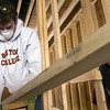 LOCAL. Boston College sophomore Kevin Meyer was one of the dozen volunteers from the school spending his Spring Break working on a Habitat home on East Poplar St. in York city. YORK DAILY RECORD/SUNDAY NEWS--JASON PLOTKIN