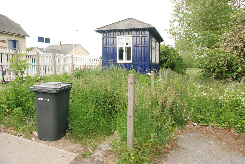 the entrance to the platform is just in front of the wheelie bin but <br /> <br /> apart from that the grass is growing out of control and it's just fields <br /> <br /> behind the waiting room as you will see in a minute