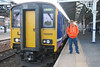 pic by Liz <br /> <br /> Ghost Station Man stands next to 150 269 after arrival at Goole on 17.16 ex Leeds