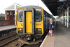 Liz stands next to<br /> <br />  153 315 <br /> <br /> Goole<br /> <br /> on  Leeds bound Platform <br /> <br /> 10th June 2013