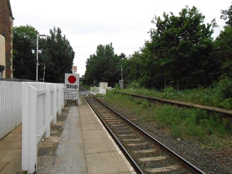 Picture by Liz <br /> <br /> Shot showing the exit to the Left and the bottom of the platform and the Road crossing