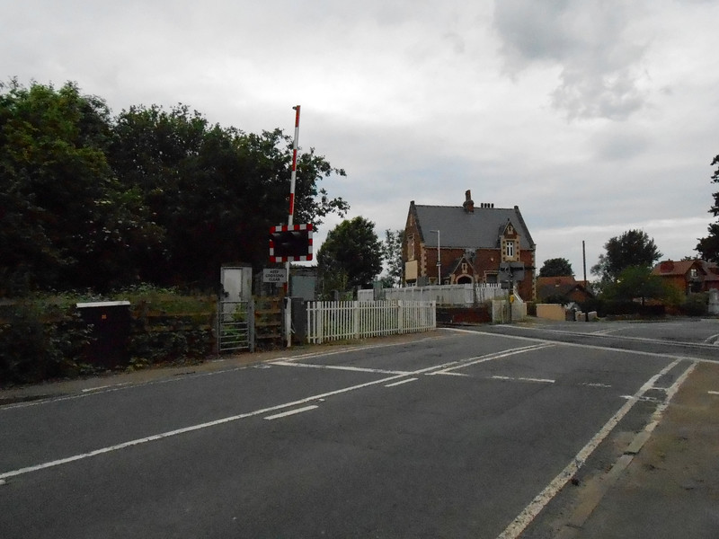 Picture by Liz <br /> <br /> Showing the approach to the station and the Level Crossing