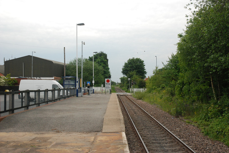 Shot of the Platform looking towards Hensall and Knottingley note <br /> <br /> the way that the platform has been shortened and raises up the train <br /> <br /> when it arrives only stops about where the white van is parked <br /> <br /> hence why i said that you have to be in the right part of the train to <br /> <br /> get off