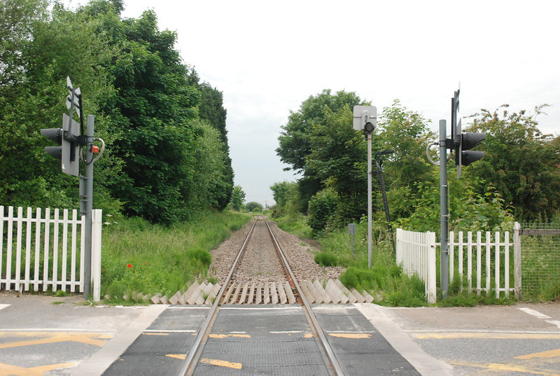 Picture taken from Selby Road level crossing looking towards <br /> <br /> Hensall and Knottingley the Line is double track all the way from <br /> <br /> Knottingley to just past Hensall where the branch to Drax power <br /> <br /> station goes off and from there on all the way to Potters Grange Jct <br /> <br /> where the line joins back up with the Branch to Hull the line is single <br /> <br /> track and gets more isolated the further you get to Rawcliffe as you <br /> <br /> will see later.