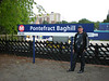 Picture by Liz :<br /> <br /> Ghost Station # 29<br /> <br /> We just couldnt leave Pontefract Baghill on the train with out a <br /> <br /> station sign shot for posterity. <br /> <br /> The Ghost Station Man is seen possing next to the station Sign