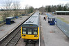 Pic of<br /> <br />  142078<br /> <br />  from the Foot Bridge as the gaurd & driver stand on the platform chatting