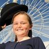 GYS 14_060_Child, bowler hat & big wheel