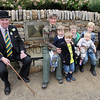 gys 2012 Tuesday: Bill Cowling and and Sally Howard-Vyse at the dedication of the bench to Richard Howard-Vyse. Sally is pictured with her grandchildren.<br /> pic: Doug Jackson