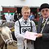 gys 2012 Wednesday: Ken Morrison presents rosettes in the Beef competition. Class: Pure or Cross Bred Heifer, first place: 820 , Charolais Cross, Mr D P Allen of Malton North Yorkshire.<br /> pic: Doug Jackson