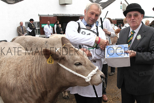 gys 2012 Wednesday: Ken Morrison presents rosettes in the Beef competition. Class: Pure or Cross Bred Heifer, first place: 814, Charolais Cross, MrK W MacGregor from Berwick Upon Tweed.<br /> pic: Doug Jackson