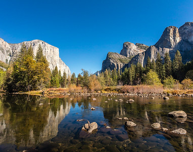 "A ""Valley View""  from the Merced River of (left to right) El Capitán, Sentinel Rock and Catherdral Rocks.  Yosemite National Park, California."