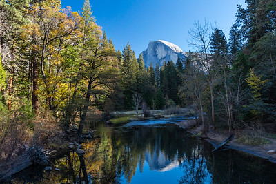 Late Autumn view of Half Dome from Sentinel Bridge over the Merced River.  Yosemite National Park, California.