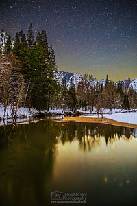 """Colors of Winter,"" The night sky over the Merced River and snow covered Yosemite Valley, Yosemite National Park, California"