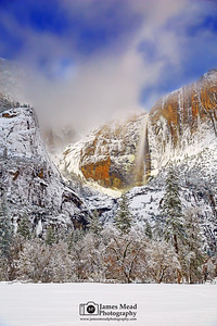 """Below Zero,"" Clouds at night over a moonlit Yosemite Falls and Cooks Meadow, Yosemite Valley, California"