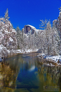 """Luminous Tranquility,"" Moonlight illuminates snow covered Half Dome, Yosemite Valley and the Merced River, Yosemite National Park, California"