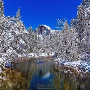 """Breath of Night,"" Moonlight illuminates snow covered Half Dome, Yosemite Valley and the Merced River, Yosemite National Park, California"