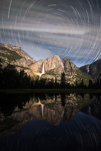 Startrail moonbow with reflection in Merced river, Yosemite National Park