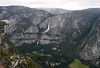 Daytime view of the Yosemite Falls area of the Valley on a cloudy day.