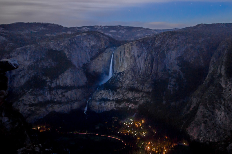 A 91 second time exposure from Glacier Point captures Yosemite Village and the Falls under late night glow. Long red streak is car tail lights. Thursday, June 8th at 4:24 AM. Stratus clouds dampened the moon glow, forcing a longer exposure to capture any reasonable detail.