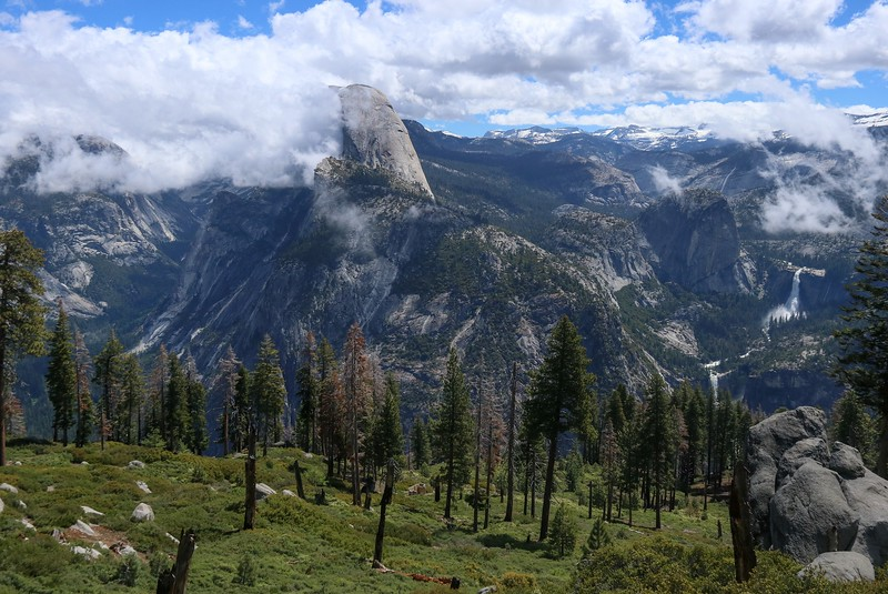 Daytime wide angle view of a scene at a switchback just south of the first official parking lot at Glacier Point.