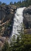Nevada Falls drops a lot farther than its lower sister Vernal Falls-594 feet for Nevada versus 317 for Vernal.