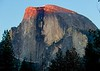 Half Dome wearing a sunset cap.